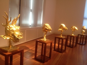 Animal heads in gold